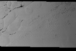 Pluto's surface is pockmarked in regions, believed to be caused by the sublimation and deposition process of atmospheric gases. Credit: NASA/JHUAPL/SwRI